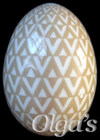Ukrainian egg. Etched Chicken Pysanka. Tessellation of triangles variation.