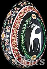 Ukrainian Easter eggs Pysanky. Goose egg with ancient Ukrainian design elements and symbols. Deer.